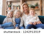 mother with three children... | Shutterstock . vector #1242913519