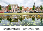 city river houses reflection... | Shutterstock . vector #1242933706
