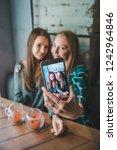 two girlfriends taking selfie... | Shutterstock . vector #1242964846