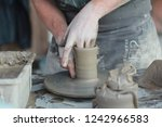 the skilled hands of a potter... | Shutterstock . vector #1242966583