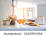 portion of toasts on a wooden... | Shutterstock . vector #1242991456