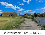 Small photo of viking village with viking ship at the ancient harbor of Bork, viking settlement, vikings, Denmark