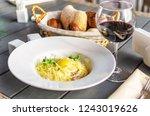 pasta carbonara on white plate... | Shutterstock . vector #1243019626