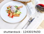 warm salad with grilled salmon | Shutterstock . vector #1243019650