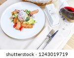 warm salad with grilled salmon | Shutterstock . vector #1243019719