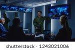 high ranking military man holds ... | Shutterstock . vector #1243021006
