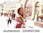 woman in shopping. happy woman... | Shutterstock . vector #1243037260