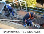 roof maintenance  workplace... | Shutterstock . vector #1243037686
