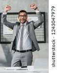 cheerful businessman triumphing ...   Shutterstock . vector #1243047979