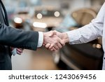 handshake of a client and... | Shutterstock . vector #1243069456