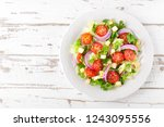 fresh vegetable salad with... | Shutterstock . vector #1243095556