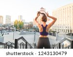 sports girl in top and legs... | Shutterstock . vector #1243130479