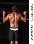 athlete muscular fitness man... | Shutterstock . vector #1243131559