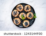 flat lay. homemade blueberry... | Shutterstock . vector #1243144930