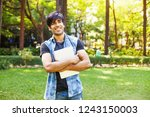 young indian man carrying...   Shutterstock . vector #1243150003