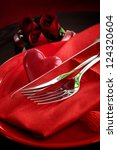 Restaurant series. Valentines day dinner with table setting in red and holiday elegant heart ornaments - stock photo