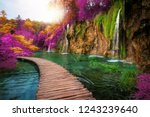 Beautiful wooden path trail for nature creek with lakes and waterfall landscape in Plitvice Lakes National Park, UNESCO natural world heritage and famous travel destination of Croatia.