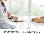 woman doctor talks to female...   Shutterstock . vector #1243241119