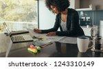 female designer working at home ... | Shutterstock . vector #1243310149