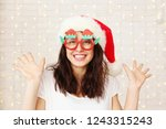 beautiful young woman wearing... | Shutterstock . vector #1243315243