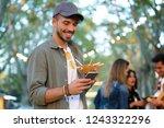 shot of attractive young man...   Shutterstock . vector #1243322296