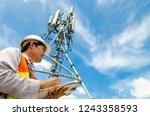 telecommunication engineer... | Shutterstock . vector #1243358593