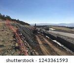 backfilling of gabion walls | Shutterstock . vector #1243361593