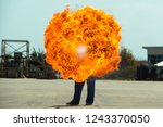 flamethrower in action.... | Shutterstock . vector #1243370050