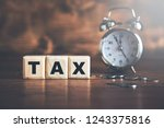 tax text on cubes with coins... | Shutterstock . vector #1243375816