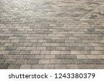 road stone grey pavement... | Shutterstock . vector #1243380379