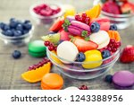 colorful french macaroons in... | Shutterstock . vector #1243388956