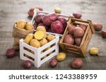 fresh raw potatoes in the crate  | Shutterstock . vector #1243388959