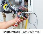 worker set up central gas... | Shutterstock . vector #1243424746