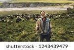 portrait of shepherd with sheep ... | Shutterstock . vector #1243439479