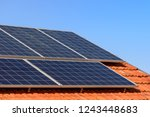 solar panels at the top of the... | Shutterstock . vector #1243448683
