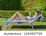 summer lifestyle portrait of... | Shutterstock . vector #1243507729