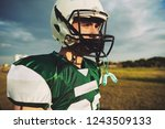 young american football player... | Shutterstock . vector #1243509133