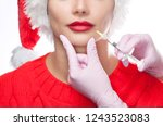 the doctor cosmetologist makes... | Shutterstock . vector #1243523083