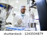 chemist checking water quality... | Shutterstock . vector #1243534879