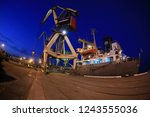 view of the sea port cranes and ... | Shutterstock . vector #1243555036