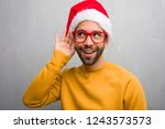 young man celebrating christmas ... | Shutterstock . vector #1243573573