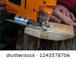 man cuts wood products  using... | Shutterstock . vector #1243578706