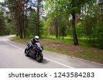 Sport Biker Racing On Road In...