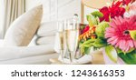 two glasses of champagne in the ... | Shutterstock . vector #1243616353