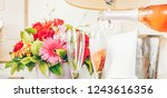 pouring champagne into glasses... | Shutterstock . vector #1243616356