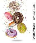 tasty doughnuts in motion... | Shutterstock . vector #1243618633