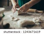 close up of woman baker hands... | Shutterstock . vector #1243671619