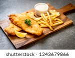 fish and chips with french... | Shutterstock . vector #1243679866