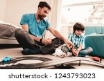 bearded father and son playing... | Shutterstock . vector #1243793023