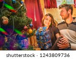 family christmas happy couple... | Shutterstock . vector #1243809736